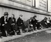 """Unemployed Men sitting on the sunny side of the San Francisco Public Library"" by Dorothea Lange. Feb. 1937. Courtesy of the San Francisco History Center."