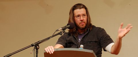 Wallace giving a reading in 2006 in San Francisco. (Wikimedia Commons.)
